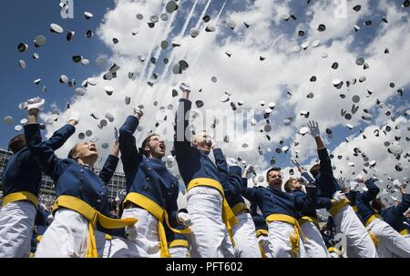 Graduates from the Air Force Academy toss their hats in the air at the conclusion of their commencement ceremony in Colorado Springs, Colorado, May 23, 2018. - Stock Photo