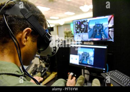 First Lt. Jay Pothula, an instructor pilot from the 33rd Flying Training Squadron at Vance Air Force Base, Oklahoma, tries out a virtual reality flight simulator during the 80th Flying Training Wing's Tech Symposium at Sheppard Air Force Base, Texas, May 22, 2018. The use of VR in undergraduate pilot training a drawn more interest from the Air Force within the past year as the service explores new technologies to train pilots. - Stock Photo