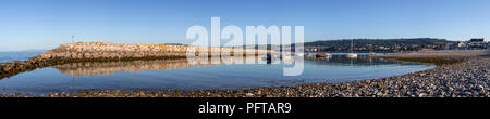 Small boats in Rhos-on-Sea harbour on the North Wales coast - Stock Photo