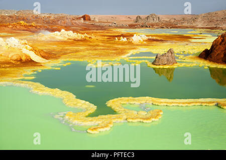 The colorful landscape of green acid ponds in Crater of Dallol Volcano the hottest place year-round on the planet located in Afar region, Ethiopia - Stock Photo