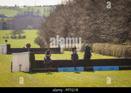 Point to point horse racing at Horseheath, Cambridgeshire, England on a sunny, cold, spring afternoon. - Stock Photo