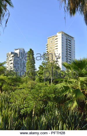 Parc Diagonal Mar - urban parkland lush greenery and modern residential towers in Sant Marti district of Barcelona Spain Europe. - Stock Photo