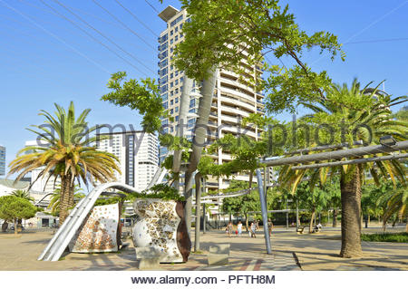 Parc Diagonal Mar - urban park lush greenery and hi-rise residential properties in Sant Marti district of Barcelona Spain Europe. - Stock Photo