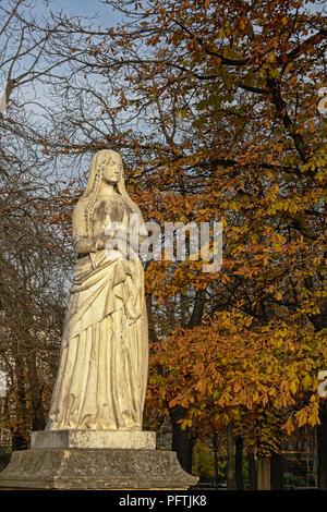 Stone sculpture of Saint Genevieve, patron saint of Paris, fount in luxembourg Gardens - Stock Photo