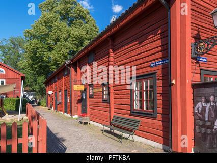 Traditional red wooden houses in Old Town Orebro (Gamla Orebro), Örebro, Närke, Sweden - Stock Photo