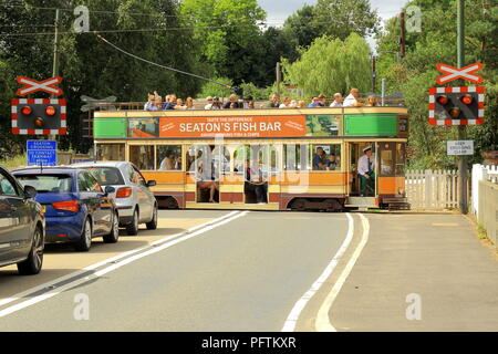 Seaton Tramway crossing road in Colyford, Devon - Stock Photo