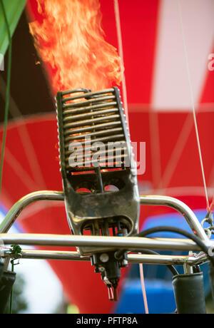 Gas burners heat the air at the Bristol Balloon Festival at Ashton Court, Aug 2018 UK