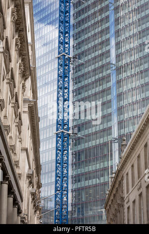 Old architecture and the new development high-rise development at 22 Bishopsgate in the City of London - the capital's financial district, on 21st August 2018, in London, England. 22 Bishopsgate is a commercial skyscraper under construction in London, United Kingdom. It will occupy a prominent site on Bishopsgate, in the City of London financial district, and is set to stand 278 m tall with 62 storeys. The project replaces an earlier plan for a 288 m tower named The Pinnacle, on which construction was started in 2008 but suspended in 2012 following the Great Recession, - Stock Photo