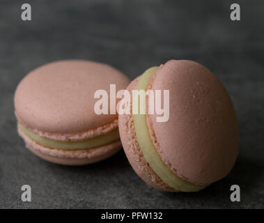 Macarons on a dark background. Close up, top view - Stock Photo