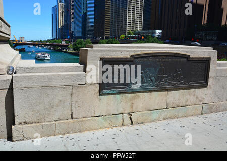 Commemorative tablet on the Michigan Avenue bridge to Louis Jolliet and Pere Marquette's Chicago River passage of 1673. - Stock Photo