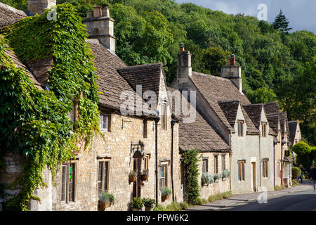 Castle Combe, UK - 9th August 2018: Castle Combe is a quintessentially English village often named as the 'prettiest village in England.' - Stock Photo