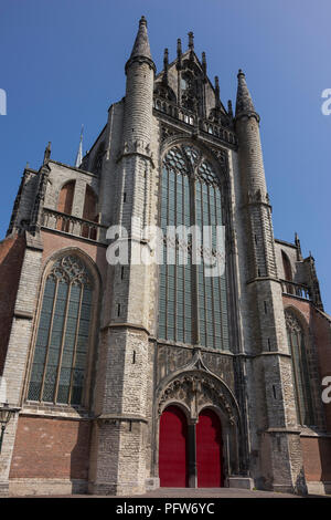 Leiden, Netherlands - July 17, 2018: Entrance and towers of the Gothic monument Hooglandse church in Leiden - Stock Photo