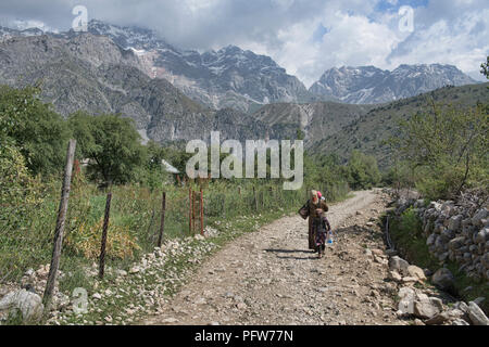 High alpine peaks behind the walnut village of Arslanbob, Kyrgyzstan - Stock Photo