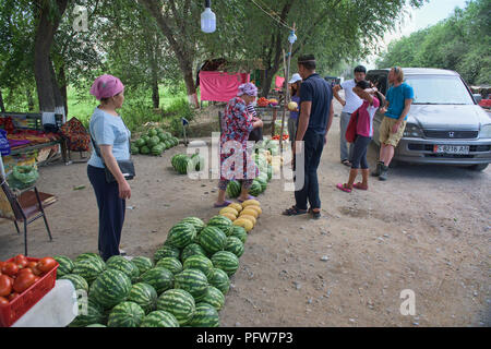 Watermelons for sale by the roadside, Osh, Kyrgyzstan - Stock Photo
