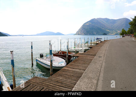 Boats moored in Peschiera Maraglio with Lake Iseo on the background, Monte Isola, Italy - Stock Photo