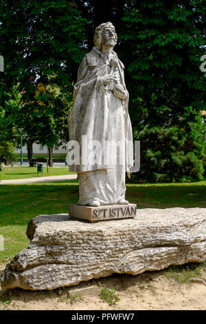 statue of szent istvan or king st stephen standing in front of szent mihaly arkangyal templom catholic church in lenti zala county hungary - Stock Photo