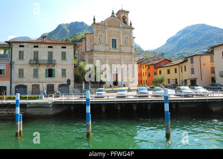 MONTE ISOLA, ITALY - AUGUST 20, 2018: view of small village with church on Monte Isola island in the middle of Lake Iseo, Italy - Stock Photo