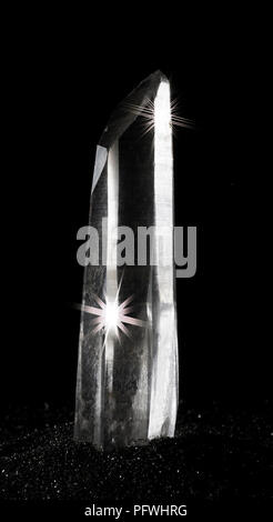 Quartz crystal that is pretty clear on a black background - Stock Photo