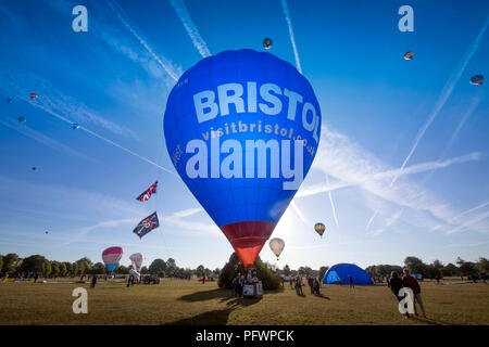 Balloons from the Bristol Balloon Festival morning mass ascent at Ashton Court approach Durdham Down in Clifton to land Aug 2018 UK
