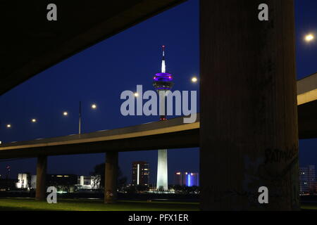 Rhinetower in Düsseldorf at night - Stock Photo