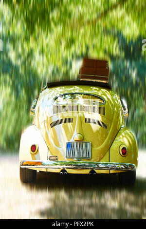 VW Beetle,1957 in motion - Stock Photo