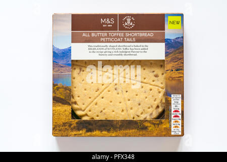 Box of M&S all butter toffee shortbread petticoat tails isolated on white background - traditionally shaped shortbread baked in Highlands of Scotland - Stock Photo