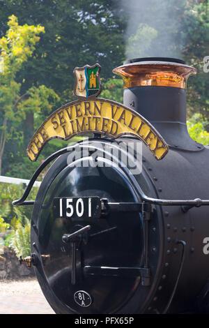 Portrait, close-up photograph of vintage UK steam engine 1501 showing 'The Severn Valley Limited' sign (front end) waiting at Arley Station, Worcs. - Stock Photo