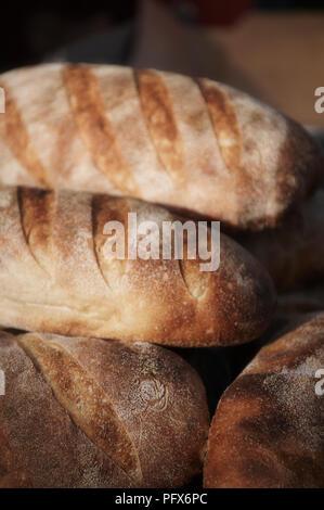 Fresh baked organic bread at a market in Daylesford, Australia. - Stock Photo