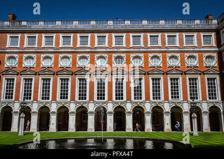 Hampton Court Palace, Richmond, London, UK - 22 April 2018 - The South Front of Hampton Court,designed by Christopher Wren, viewed from Fountain court - Stock Photo