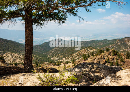 High vantage point view of forest fire smoke; town of Salida; Arkansas River Valley & Rocky Mountains beyond from The Crater; USA - Stock Photo