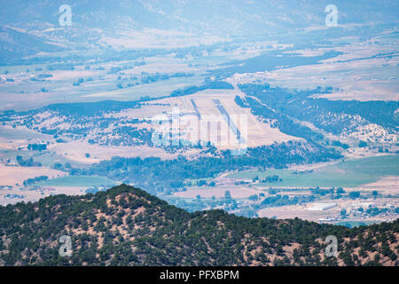 Forest fire smoke; high vantage point view of Harriett Alexander Air Field; Salida & Arkansas River Valley from The Crater; USA - Stock Photo