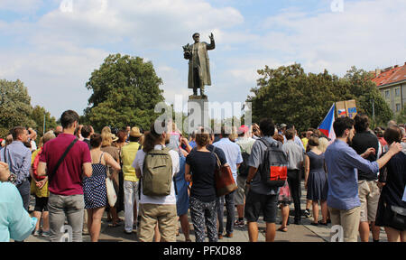 A several people protest after an unveiling of restored memorial to Soviet Marshal Konev with new plaques describing his life and work, in Prague, Cze - Stock Photo