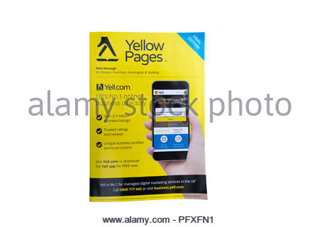 Last Edition of the Yellow Pages, isolated on a white background - Stock Photo
