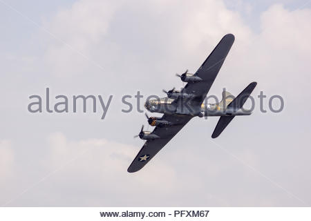 Boeing B-17G Flying Fortress 'Sally B' on flyby at Duxford Air Show - Stock Photo
