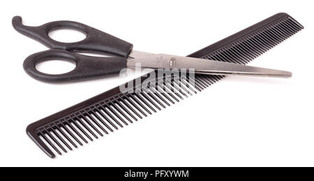 Comb and scissors isolated on the white background - Stock Photo