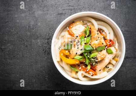 Udon stir-fry noodles with chicken and vegetables. - Stock Photo