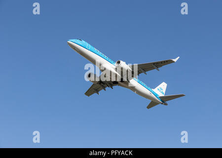 Airborne KLM Embraer twin engined airliner, PH-EZT - Stock Photo