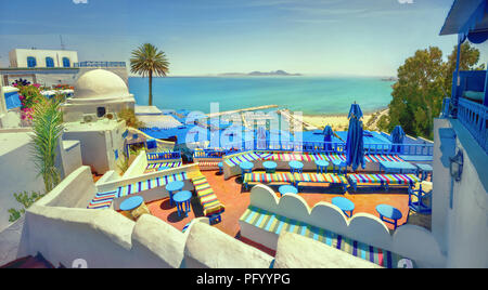 Panoramic view of seaside and cafe terrace in Sidi Bou Said at sunset. Tunisia, North Africa - Stock Photo