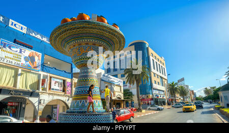 Street photo with ceramic art sculpture on road and traffic in city centre. Nabeul. Tunisia, North Africa - Stock Photo