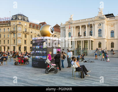 Zurich, Switzerland - September 27, 2017: people on Sechselautenplatz square, the meeting point of the Zurich Film Festival, buildings at the square.  - Stock Photo