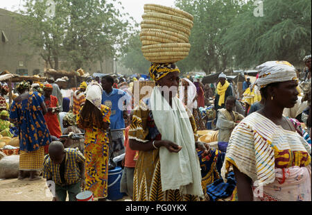 People at the Monday market at The Great Mosque in Djenne, Mali                FOR EDITORIAL USE ONLY - Stock Photo