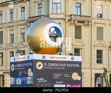 Zurich, Switzerland - September 27, 2017: partial view of the meetingpoint stand of the Zurich Film Festival on Sechselautenplatz square, buildings at - Stock Photo