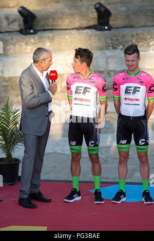 Malaga, Spain. 24th August, 2018. EF Education First-Drapac p/b Cannondale cycling team's Colombian cyclist Rigoberto Urán (C) talks to Spanish journalist Carlos de Andres on the stage at Roman Theater during the presentation of the cycling teams competing in La Vuelta cycling tour in Malaga, southern Spain, 23 August 2018 (issued on 24 August 2018). La Vuelta runs from 25 August to 16 September. EFE/ Daniel Perez Credit: EFE News Agency/Alamy Live News - Stock Photo
