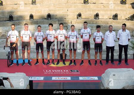 Malaga, Spain. 24th August, 2018. Burgos BH cycling team's members pose on the stage at Roman Theater during the presentation of the cycling teams competing in La Vuelta cycling tour in Malaga, southern Spain, 23 August 2018 (issued on 24 August 2018). La Vuelta runs from 25 August to 16 September. EFE/ Daniel Perez Credit: EFE News Agency/Alamy Live News - Stock Photo