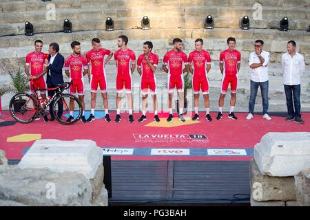 Malaga, Spain. 24th August, 2018. Cofidis cycling team's members pose on the stage at Roman Theater during the presentation of the cycling teams competing in La Vuelta cycling tour in Malaga, southern Spain, 23 August 2018 (issued on 24 August 2018). La Vuelta runs from 25 August to 16 September. EFE/ Daniel Perez Credit: EFE News Agency/Alamy Live News - Stock Photo