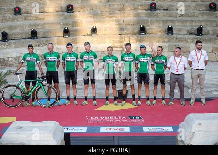 Malaga, Spain. 24th August, 2018. Caja Rural-Seguros RGA cycling team's members pose on the stage at Roman Theater during the presentation of the cycling teams competing in La Vuelta cycling tour in Malaga, southern Spain, 23 August 2018 (issued on 24 August 2018). La Vuelta runs from 25 August to 16 September. EFE/ Daniel Perez Credit: EFE News Agency/Alamy Live News - Stock Photo