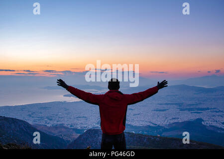 Success! Achieve your dreams, conquer the mountain. Sunset of Athens Greece - Stock Photo