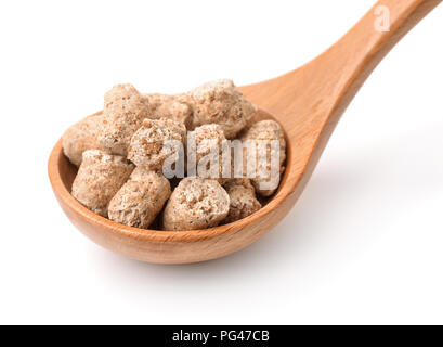Spoon with oats bran pellets isolated on white - Stock Photo