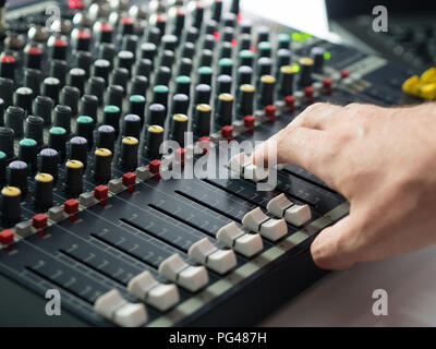 Dj mixing desk in music studio - Stock Photo