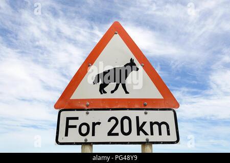 Road sign warning of brown hyaena - Stock Photo